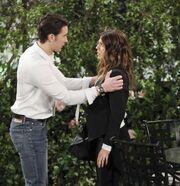 Chad grabs Abigail's shoulder
