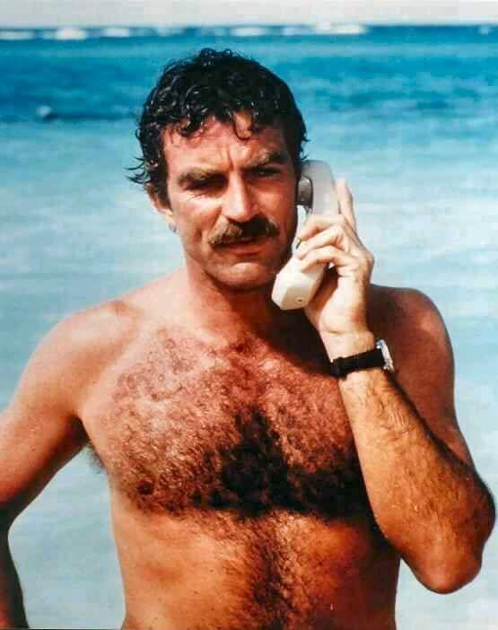 magnum-pi-tom-selleck shirtless at the beach on a cordless phone