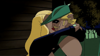 Black Canary and Green Arrow kiss