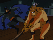 Batman fights an oddly clothed thug