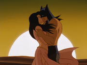 Talia and Batman kiss