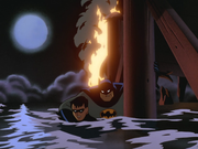 Batman saves Robin from the explosion