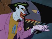 Joker shows Batman his resemblance to the shark