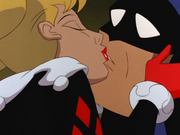 Harley kisses Batman