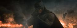 Batman atirando no Apocalipse