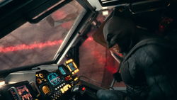 Bruce na luta no porto de Gotham