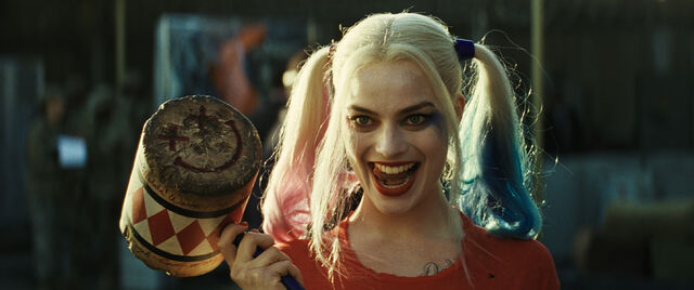 File:Harley Quinn holds a mallet.jpg