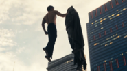 Superman lifts Batman