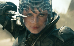 Faora brandishing a knife