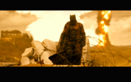 Knightmare Batman walks away from an explosion