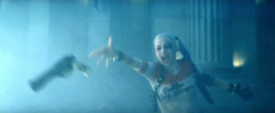 Harley throwing a gun at Deadshot