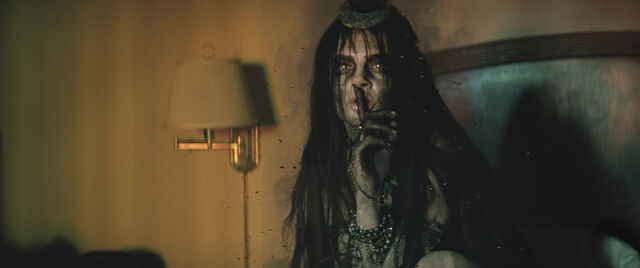 File:Enchantress holds her finger to her mouth.jpg