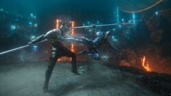 Orm kicks Arthur during their duel