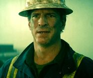 Mark Gibbon as Roughneck