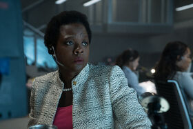 Amanda Waller worryingly watches the screen