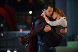 Superman carrying Lois Lane