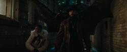Batman glides down to capture Floyd Lawton