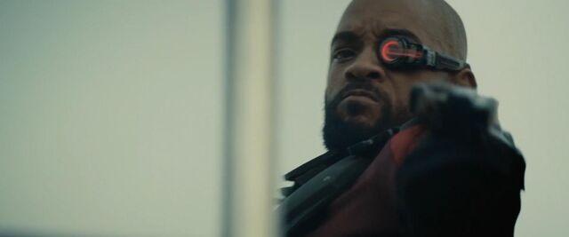 File:Deadshot taking aim at his target for Angelo.jpg