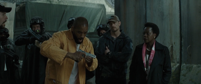 File:Floyd Lawton is given a gun after imprisonment.png