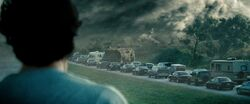 Clark watches as his father is killed by a tornado