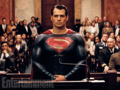 Superman stands before the court.png
