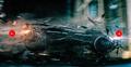 Batmobile crashing through rubble.png