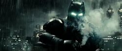 Batman uses a gas grenade