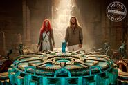 Mera and Arthur look at an artifact