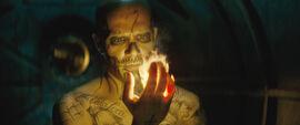 El Diablo holds fire in his hand