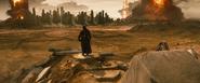 Batman stands over a wasteland