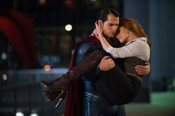 Superman carries Lois Lane