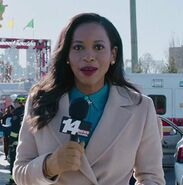 Nneka Elliott as Newscaster
