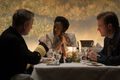 Amanda Waller sits at dinner with government officials.jpg