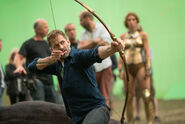 JL-BTS - Zack Snyder with amazon bow on set