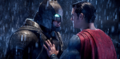 Superman holds back an armored Batman.png