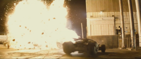 Batmobile near explosion image