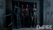 Batman, Flash, Cyborg and Wonder Woman stand in a doorway