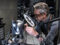 Alfred tinkering with the technology of the Batsuit's cowl.png