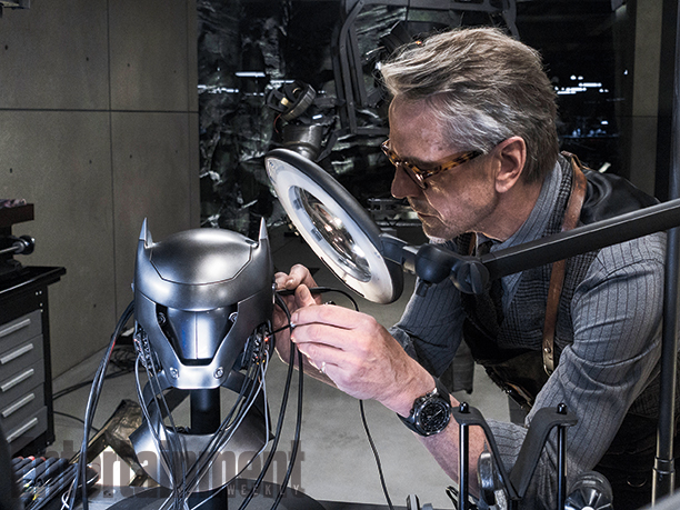 File:Alfred tinkering with the technology of the Batsuit's cowl.png