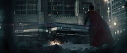 Zod kicks an oil truck at Superman