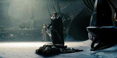 Zod standing over Jor-El