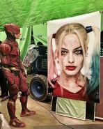 JL-BTS - Ezra Miller viewing a portrait of Harley Quinn on set