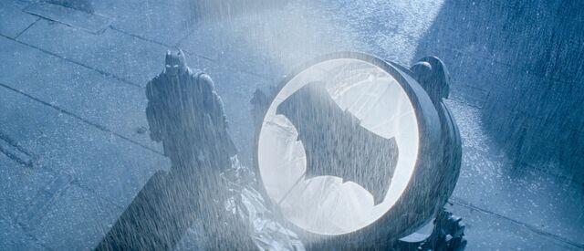 File:Batman stands by the Batsignal - promotional still.jpg