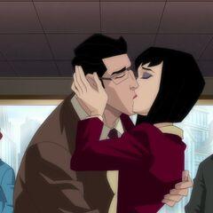 Lois and Clark kiss.