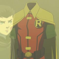 Damian looking at the Robin costume.