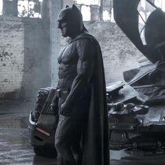 Batman alongside The Batmobile.