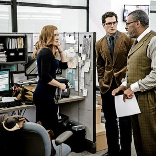 Perry White with his reporters: Lois Lane & Clark Kent.