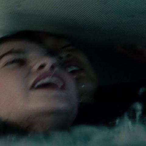 Lana on the sinking bus.
