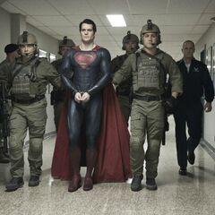 Colonel Hardy taking Kal-El into custody.