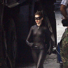 Hathaway with her full Catwoman costume on <i><a href=